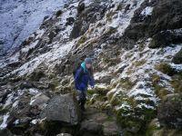 Phoebe climbing a mountain